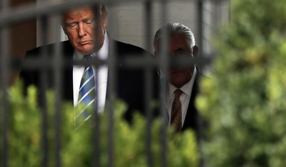 President Donald Trump, left, and Secretary of State Rex Tillerson, right, walk out together to speak to members of the media following their meeting at Trump National Golf Club in Bedminster, N.J., Friday, Aug. 11, 2017. (AP Photo/Pablo Martinez Monsivais)