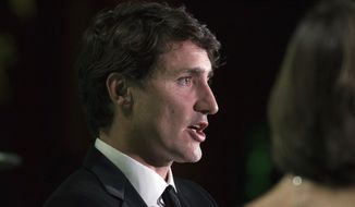 Canadian Prime Minister Justin Trudeau participates in a keynote conversation at the 2017 Fortune Most Powerful Women Summit at the Smithsonian American Art Museum in Washington, Tuesday, Oct. 10, 2017. (AP Photo/Sait Serkan Gurbuz)