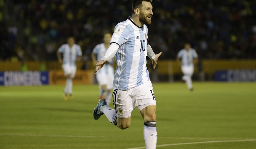 Argentina's Lionel Messi celebrates after scoring his third goal against Ecuador during their 2018 World Cup qualifying soccer match at the Atahualpa Olympic Stadium in Quito, Ecuador, Tuesday, Oct. 10, 2017. (AP Photo/Fernando Vergara)