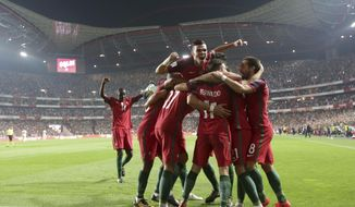 Portugal's Andre Silva celebrates with his teammates after scoring goal during the World Cup Group B qualifying soccer match between Portugal and Switzerland at the Luz stadium in Lisbon, Tuesday, Oct. 10, 2017. (AP Photo/Armando Franca)