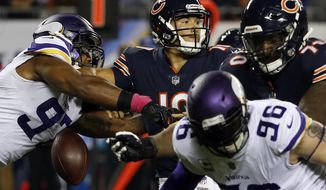 Minnesota Vikings defensive end Everson Griffen (97) strips the ball from Chicago Bears quarterback Mitchell Trubisky (10) during the first half of an NFL football game, Monday, Oct. 9, 2017, in Chicago. (AP Photo/Charles Rex Arbogast)