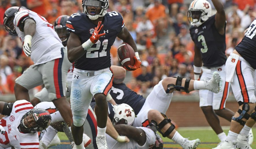 FILE - In this Oct. 7, 2017, file photo, Auburn running back Kerryon Johnson (21) carries the ball during the first half of an NCAA college football game against Mississippi, in Auburn, Ala. No. 10 Auburn's offense has made huge strides since the Clemson game with the progress of quarterback Jarrett Stidham and the touchdown tear of tailback Kerryon Johnson. (AP Photo/Thomas Graning, File)