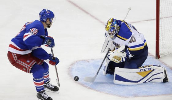 St. Louis Blues goalie Carter Hutton (40) stops a shot on the goal by New York Rangers' Michael Grabner (40) during the third period of an NHL hockey game Tuesday, Oct. 10, 2017, in New York. The Blues won 3-1. (AP Photo/Frank Franklin II)