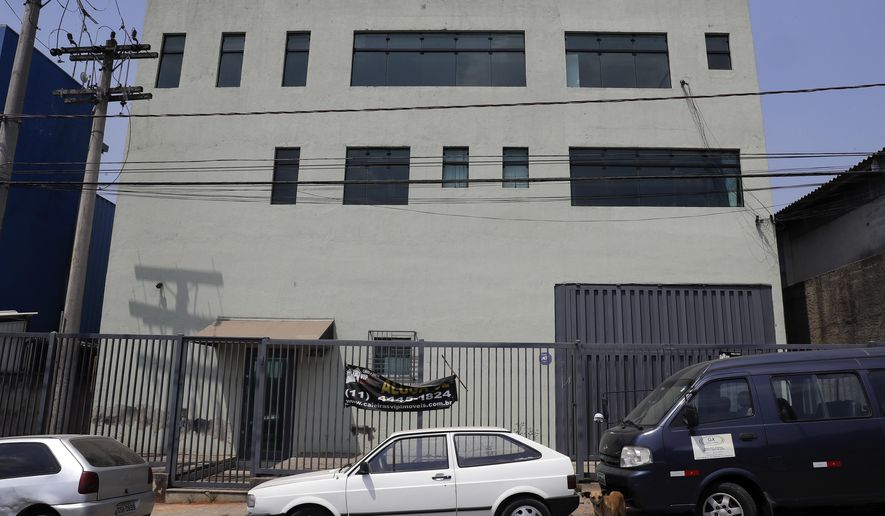 This Sept. 28, 2017 photo shows the facade of what once was the Stylofino picture frame factory owned by members of Rhema Community Evangelical Ministry, affiliated with the Word of Faith Fellowship church, in Franco da Rocha, Brazil, in the greater Sao Paulo area. The business and its labor practices are under investigation by Brazilian authorities, just one of several inquiries launched into a pair of Brazilian churches connected to Word of Faith Fellowship, a secretive evangelical sect based in Spindale, North Carolina. (AP Photo/Andre Penner)