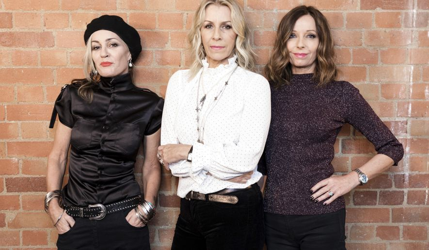 In this Friday, Oct. 6, 2017 photo, members of 'Bananarama' from left, Siobhan Fahey, Sara Dallin, and Keren Woodward, pose for a portrait in London to promote their new tour. Bananarama is back together after thirty years  and it is touring the U.S. for the first time. The girl group's original members _ Sarah Dallin, Keren Woodward and Siobhan Fahey  say they began rehearsals this week for the shows, due to start in February. (Photo by Grant Pollard/Invision/AP)