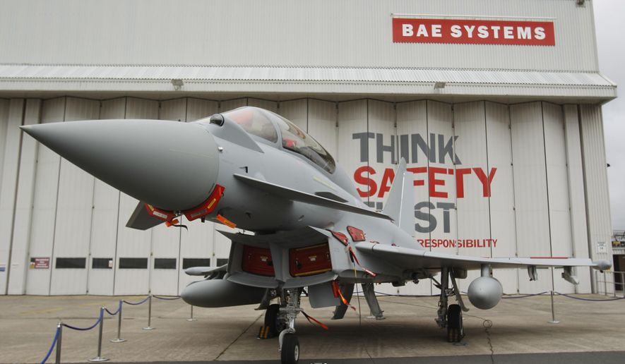 "FILE - This is a  Sept. 7, 2012 file photo of a Eurofighter Typhoon at BAE Systems, Warton Aerodrome, near Warton northwest England. British defense company BAE Systems is cutting almost 2,000 jobs in its military, maritime and intelligence services in an effort to boost competitiveness. CEO Charles Woodburn said in a statement Tuesday Oct. 10, 2017, that the actions are necessary to ""align our workforce capacity more closely with near-term demand and enhance our competitive position to secure new business."" (Peter Byrne/PA, File via AP)"