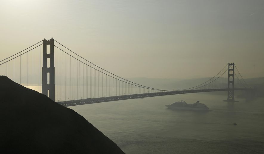A cruise ship passes beneath the Golden Gate Bridge as smoke from wildfires blankets the San Francisco skyline in this Tuesday, Oct. 10, 2017, file photo.  (AP Photo/Eric Risberg) **FILE**