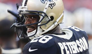 FILE - In this Aug. 10, 2017, file photo, New Orleans Saints running back Adrian Peterson stands on the sideline during warm ups before an NFL preseason football game against the Cleveland Browns, in Cleveland. (AP Photo/Ron Schwane, File)
