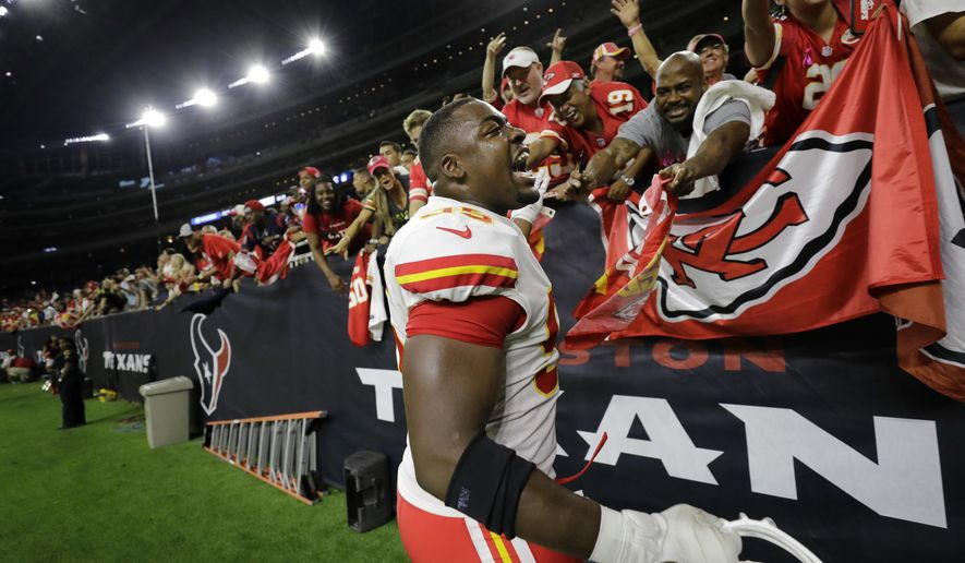 Kansas City Chiefs defensive end Chris Jones (95) celebrates with fans after the team's win over Houston Texans in an NFL football game, Sunday, Oct. 8, 2017, in Houston. (AP Photo/David J. Phillip)