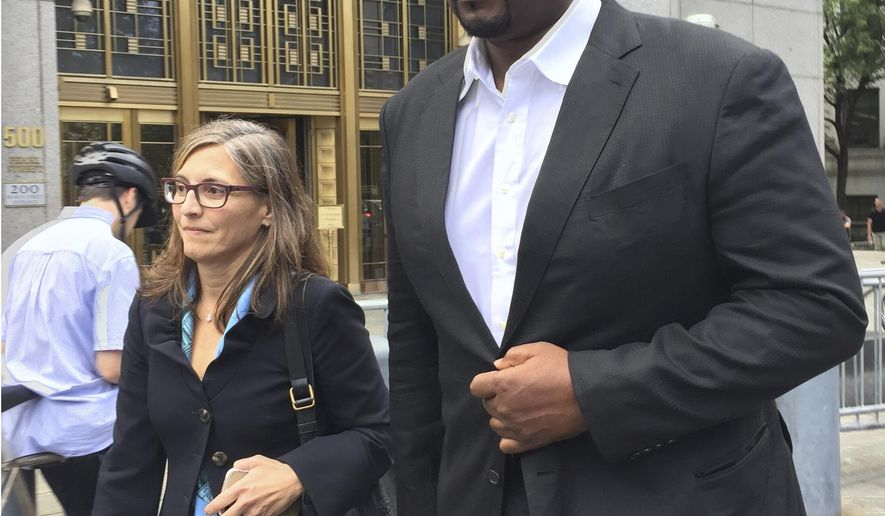 Suspended Auburn University assistant men's basketball coach, Chuck Person, leaves Manhattan federal court in New York, Tuesday, Oct. 10, 2017, after an initial appearance before a magistrate judge. Person will remain free on $100,000 bond. He awaits trial along with three other coaches in a case in which the coaches and others are charged with using hundreds of thousands of dollars in bribes to influence the choices star athletes make about schools, sponsors, agents and financial advisers. (AP Photo/Larry Neumeister)
