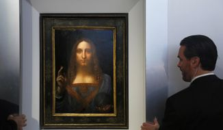 "Security guards open a door to reveal ""Salvator Mundi"" by Leonardo da Vinci during a news conference at Christie's in New York, Tuesday, Oct. 10, 2017. The piece, which was painted around 1500, is one of fewer than twenty da Vinci paintings known to exist. After public exhibitions around the world, the auction is scheduled to take place on Nov. 15, 2017. (AP Photo/Seth Wenig)"