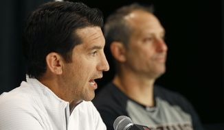Arizona Diamondbacks general manager Mike Hazen, left, speaks during a news conference as Diamondbacks manager Torey Lovullo, right, listens at Chase Field Tuesday, Oct. 10, 2017, in Phoenix. The Diamondbacks were eliminated from the baseball playoffs in the National League Division Series by the Los Angeles Dodgers. (AP Photo/Ross D. Franklin)