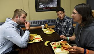 In this Sept. 28, 2017, photo, from left, Joe Nickelson, Gordon Basswood and Tom Johnson eat lunch at at the Minnesota Adult and Teen Challenge in Minneapolis. (Jean Pieri/Pioneer Press via AP)