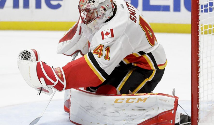 Calgary Flames goalie Mike Smith blocks a shot against the Anaheim Ducks during the second period of an NHL hockey game in Anaheim, Calif., Monday, Oct. 9, 2017. (AP Photo/Chris Carlson)