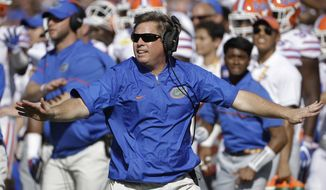 FILE - In this Jan. 2, 2017 file photo, Florida head coach Jim McElwain reacts to a dropped pass by Iowa during the first half of the Outback Bowl NCAA college football game in Tampa, Fla. McElwain has a new solution to his three-year-old problem. He wants to pick up the pace. The unranked and nearly irrelevant Gators want to play with a faster tempo when they host Texas A&M on Saturday night.  (AP Photo/Chris O'Meara, File)