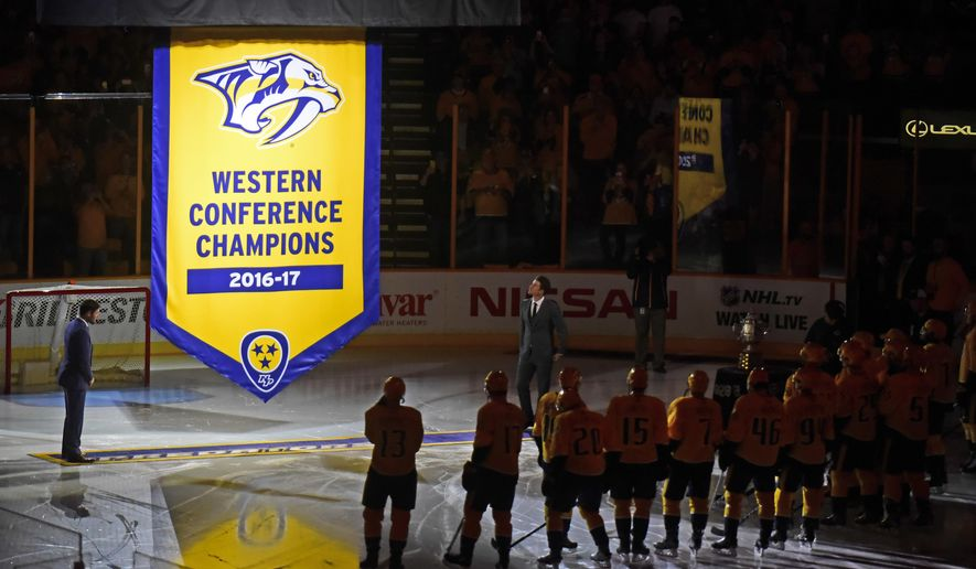 The Western Conference Championship banner is raised by the Nashville Predators before an NHL hockey game between the Predators and the Philadelphia Flyers Tuesday, Oct. 10, 2017, in Nashville, Tenn. (AP Photo/Mike Strasinger)