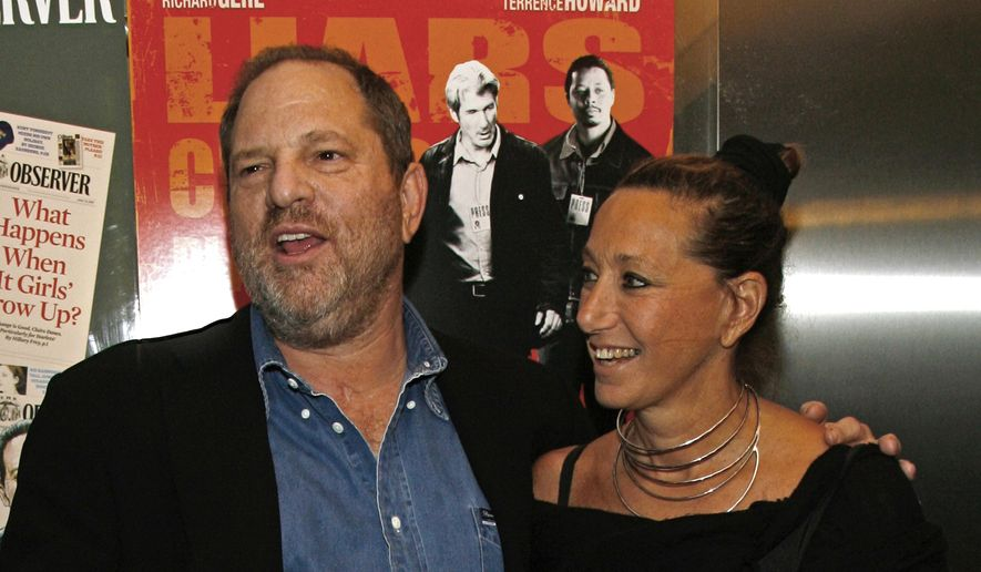 "In this Aug. 22, 2007, file photo, Harvey Weinstein and Donna Karan arrive at the premiere of ""The Hunting Party"" at the Paris Theater in New York. Karan apologized on Monday, Oct. 10, 2017, after offering praise for Weinstein the night before following his firing from his company amid allegations of sexual harassment lasting decades. (AP Photo/Rick Maiman, File)"
