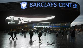 FILE - This Oct. 15, 2012 file photo shows spectators arriving at the Barclays Center in the Brooklyn borough of New York. Islanders owner Jon Ledecky said the team will play at Barclays Center through the end of next season, and the 'singular focus' beyond that is for a new arena at Belmont Park, Tuesday, Oct. 10, 2017. (AP Photo/John Minchillo, File)
