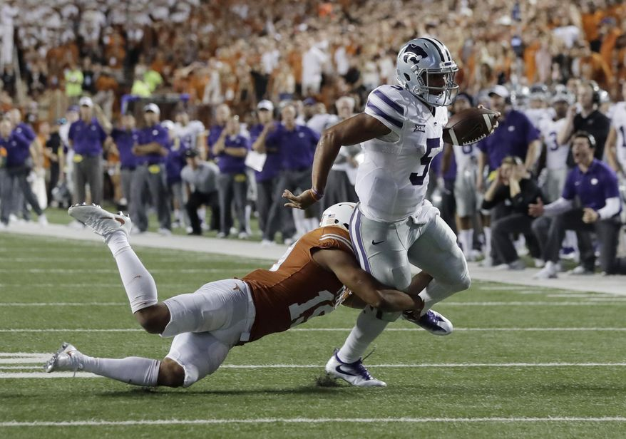 Kansas State quarterback Alex Delton (5) is stopped short of the goal line by Texas defensive back Brandon Jones (19) overtime in an NCAA college football game, Saturday, Oct. 7, 2017, in Austin, Texas. Texas won 40-34 in overtime. (AP Photo/Eric Gay)