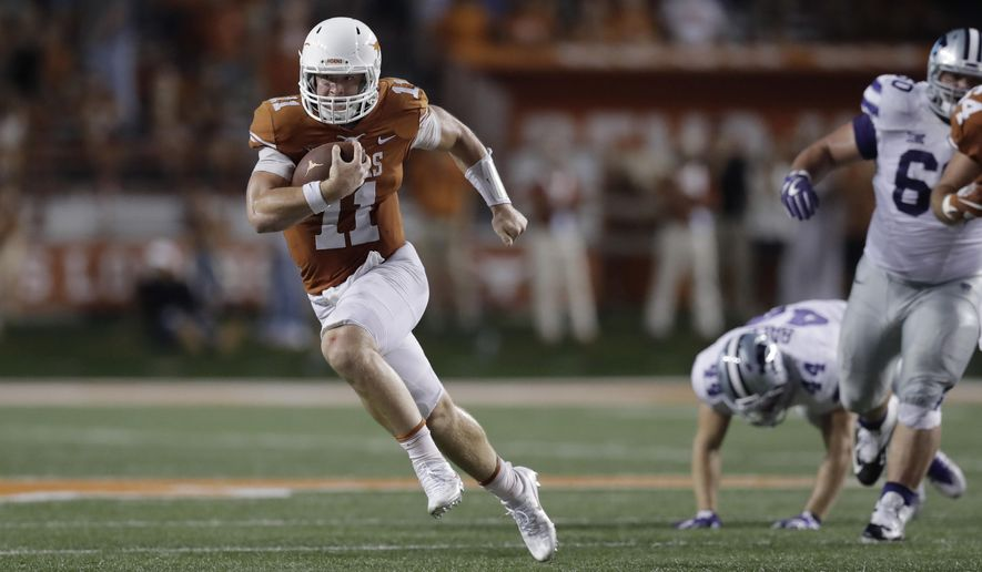 Texas quarterback Sam Ehlinger (11) runs for 15 yards against Kansas State during the second half of an NCAA college football game, Saturday, Oct. 7, 2017, in Austin, Texas. Texas won 40-34 in overtime. (AP Photo/Eric Gay)