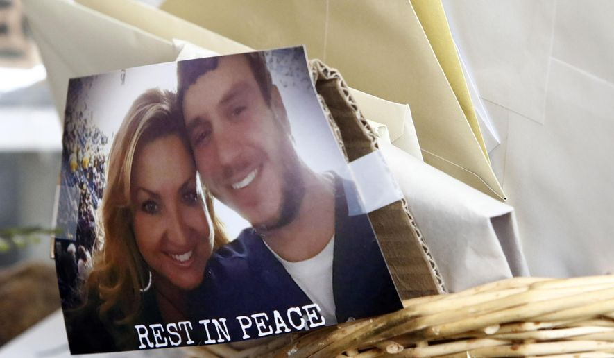 A photo of Scott Melton and his wife, Heather is seen tapped to a basket of cards and letter before the funeral for Sonny Melton Tuesday, Oct. 10, 2017, in Big Sandy, Tenn. Melton, of Paris, Tenn., was one of the victims who died in the Oct. 1 mass shooting in Las Vegas. (AP Photo/Wade Payne)