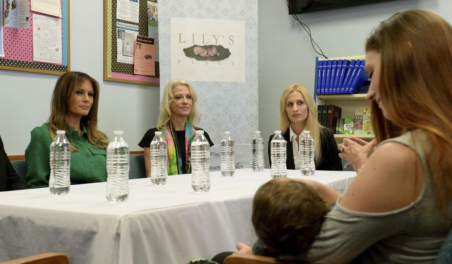 First lady Melania Trump, left, participates in a roundtable discussion of Lily's Place in Huntington, W.Va., Tuesday, Oct. 10, 2017. To Trump's right are Kellyanne Conway, special advisor to the president, and Lily's Place Executive Director Rebecca Crowder. Lily's Place is the nations first nonprofit infant recovery center that also provides services to parents and families dealing with addiction. (Chris Dorst /Charleston Gazette-Mail via AP)