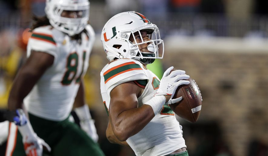 FILE - In this Friday, Sept. 29, 2017, file photo, Miami's Travis Homer (24) runs the ball into the end zone for a touchdown against Duke during the second half of an NCAA college football game in Durham, N.C. Homer came into this season as an afterthought. He's now going to be the replacement for the injured Mark Walton as the starter for the unbeaten and 11th-ranked Hurricanes, and Miami's ACC hopes might be on his shoulders. (AP Photo/Gerry Broome, File)