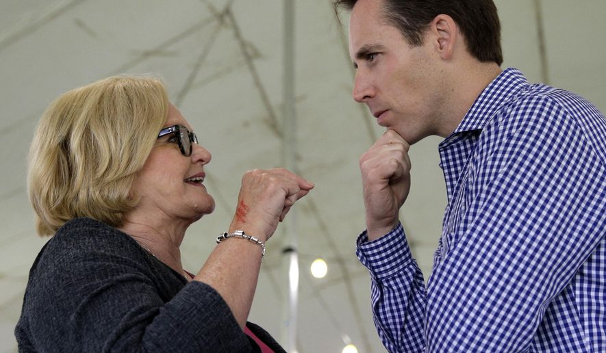 FILE - In this Aug. 17, 2017, file photo, Democratic Sen. Claire McCaskill, left, talks with Republican Missouri Attorney General Josh Hawley during the Governor's Ham Breakfast at the Missouri State Fair in Sedalia, Mo. Hawley announced in a video to be released Tuesday that he will run for the U.S. Senate in 2018 against the incumbent McCaskill. Hawley was elected attorney general in 2016, his first-ever elected office. (AP Photo/Charlie Riedel, File)