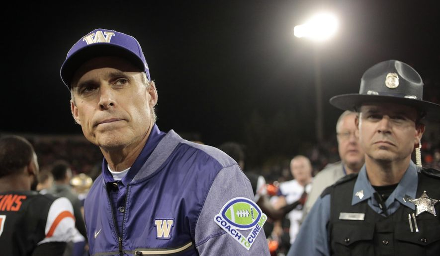 FILE - In this Sept. 30, 2017, file photo, Washington head coach Chris Petersen after an NCAA college football game, in Corvallis, Ore. Pac-12 After Dark, those West Coast TV games that start at about 11 p.m. on the East Coast, are the talk of the conference after Washington coach Chris Petersen weighed in. Some say it's a great showcase for the conference, but at least one coach said the next day, his team is basically zombies. (AP Photo/Timothy J. Gonzalez, File)