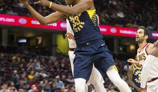 FILE - In this Oct. 6, 2017, file photo, Indiana Pacers' Myles Turner (33) takes a shot against the Cleveland Cavaliers during the third quarter of an NBA preseason basketball game, in Cleveland. Myles Turner embraces his new role with the Pacers. The 21-year-old center knows this is his team. (AP Photo/Scott R. Galvin, File)