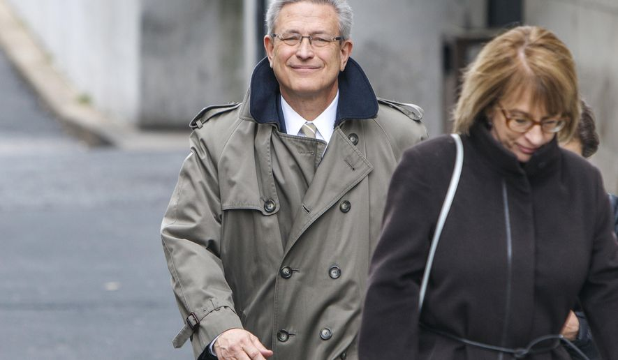 FILE - In this March 13, 2017, file photo, former Penn State Athletic Director Tim Curley leaves the Dauphin County Courthouse in Harrisburg, Pa.  after pleading guilty to endangering the welfare of a child in the in the Jerry Sandusky child molestation case. Curley has been released from jail after 2½ months and is now serving the house-arrest portion of his sentence in the Jerry Sandusky sex abuse scandal. Pennlive.com reports the 63-year-old defendant was released from the Centre County jail on Oct. 3. (Dan Gleiter/PennLive.com via AP, File)
