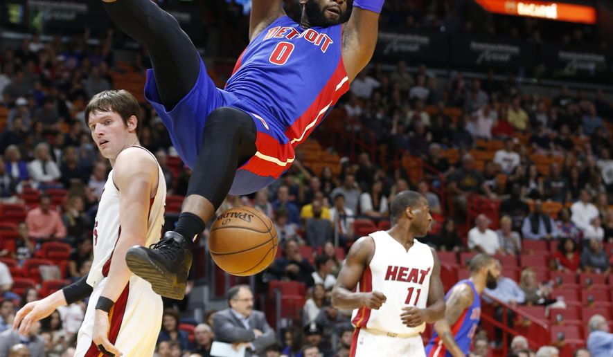 FILE - In this Jan. 28, 2017, file photo, Detroit Pistons center Andre Drummond (0) hangs from the rim after dunking against Miami Heat forward Luke Babbitt, left, and guard Dion Waiters (11) during the first half of an NBA basketball game, in Miami. After falling back out of the playoffs last season, the Detroit Pistons are hoping for an improved Andre Drummond and a healthier Reggie Jackson in 2017-18. (AP Photo/Wilfredo Lee, File)