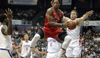 FILE - In this Tuesday, Oct. 3, 2017, file photo, Toronto Raptors guard DeMar DeRozan (10) makes a pass through the Los Angeles Clippers defense during the first quarter of a preseason NBA basketball game in Honolulu. Toronto spent big over the summer to retain both Kyle Lowry and forward Serge Ibaka, acquired from Orlando at last season's trade deadline, and keep them teamed up with All-Star guard DeMar DeRozan.  (AP Photo/Marco Garcia, File)