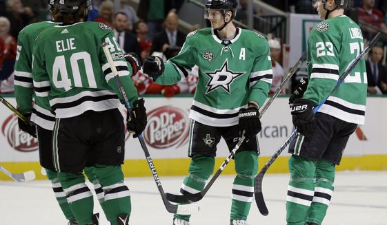 Dallas Stars' Remi Elie (40), John Klingberg, center, and Esa Lindell (23) celebrate a goal scored by Klingberg in the first period of an NHL hockey game against the Detroit Red Wings on Tuesday, Oct. 10, 2017, in Dallas. (AP Photo/Tony Gutierrez)
