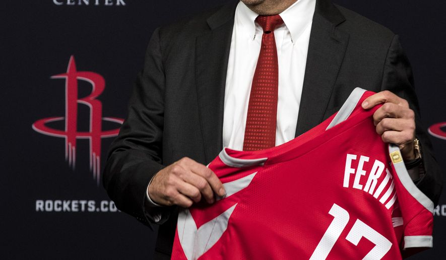 Houston Rockets owner Tilman Fertitta holds a jersey during an introductory news conference, Tuesday, Oct. 10, 2017, in Houston. (Brett Coomer/Houston Chronicle via AP)