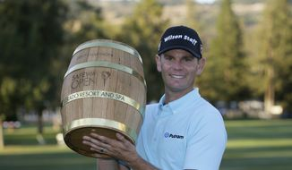 Brendan Steele poses with his trophy on the 18th green of the Silverado Resort North Course after winning the Safeway Open PGA golf tournament Sunday, Oct. 8, 2017, in Napa, Calif. (AP Photo/Eric Risberg)