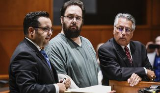 Robert Ritchie, center, stands with his attorneys Frank Schiavone IV, left, and Frank Schiavone III, before being sentenced to seven years in prison in Warren County Common Pleas Court on Tuesday, Oct. 10, 2017, in Lebanon, Ohio. Ritchie was convicted of involuntary manslaughter in connection with his son's scalding death in March 2016.  (Nick Graham/The Journal-News via AP)