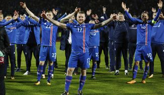 Iceland's captain Aron Gunnarsson celebrates at the end of the World Cup Group I qualifying soccer match between Iceland and Kosovo in Reykjavik, Iceland, Monday Oct. 9, 2017. (AP Photo/Brynjar Gunnarsson).