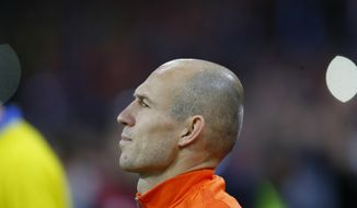 Netherland's Arjen Robben stands during the national anthem prior to the start of a World Cup Group A soccer qualifying match between the Netherlands and Sweden at the ArenA stadium in Amsterdam, Netherlands, Tuesday, Oct. 10, 2017. (AP Photo/Peter Dejong)