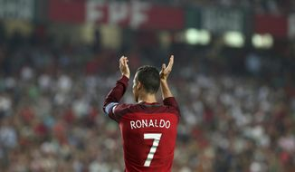 Portugal's Cristiano Ronaldo celebrates at the end of the World Cup Group B qualifying soccer match between Portugal and Switzerland at the Luz stadium in Lisbon, Tuesday, Oct. 10, 2017. (AP Photo/Armando Franca)