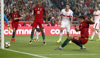 Portugal's Andre Silva, right, scores goal during the World Cup Group B qualifying soccer match between Portugal and Switzerland at the Luz stadium in Lisbon, Tuesday, Oct. 10, 2017. (AP Photo/Armando Franca)