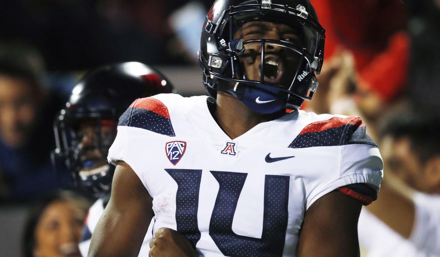 FILE - In this Oct. 7, 2017, file photo, Arizona quarterback Khalil Tate celebrates after rushing for a touchdown against Colorado in the second half of an NCAA college football game, in Boulder, Colo. Arizona won 45-42. Tate turned in the top rushing performance of the season in the Football Bowl Subdivision, piling up 327 yards on just 14 carries against Colorado.(AP Photo/David Zalubowski, File)