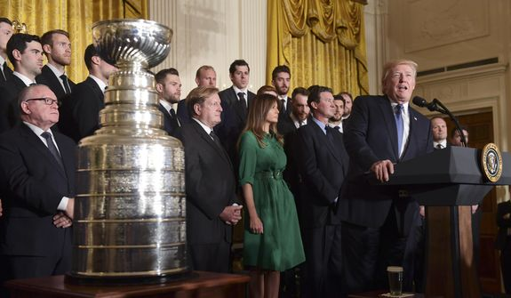 President Donald Trump speaks during a ceremony to honor the 2017 NHL Stanley Cup Champion Pittsburgh Penguins, Tuesday Oct. 10, 2017, in the East Room of the White House in Washington. (AP Photo/Susan Walsh) ** FILE **