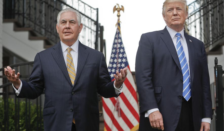"""FILE - In this Aug. 11, 2017, file photo, Secretary of State Rex Tillerson, left, speaks following a meeting with President Donald Trump at Trump National Golf Club in Bedminster, N.J. Trump challenged Tillerson to """"compare IQ tests,"""" delivering a sharp-edged ribbing that threw a bright spotlight on his seemingly shaky relationship with his top diplomat. The White House insisted he was only joking. (AP Photo/Pablo Martinez Monsivais, File)"""