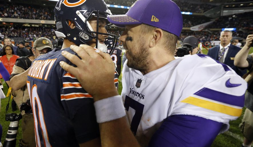 Chicago Bears quarterback Mitchell Trubisky (10) and Minnesota Vikings quarterback Case Keenum (7) greet each other after an NFL football game, Monday, Oct. 9, 2017, in Chicago. The Vikings won 20-17. (AP Photo/Charles Rex Arbogast)