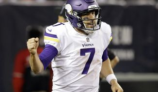 Minnesota Vikings quarterback Case Keenum (7) celebrates a touchdown during the second half of an NFL football game against the Chicago Bears, Monday, Oct. 9, 2017, in Chicago. (AP Photo/Darron Cummings)