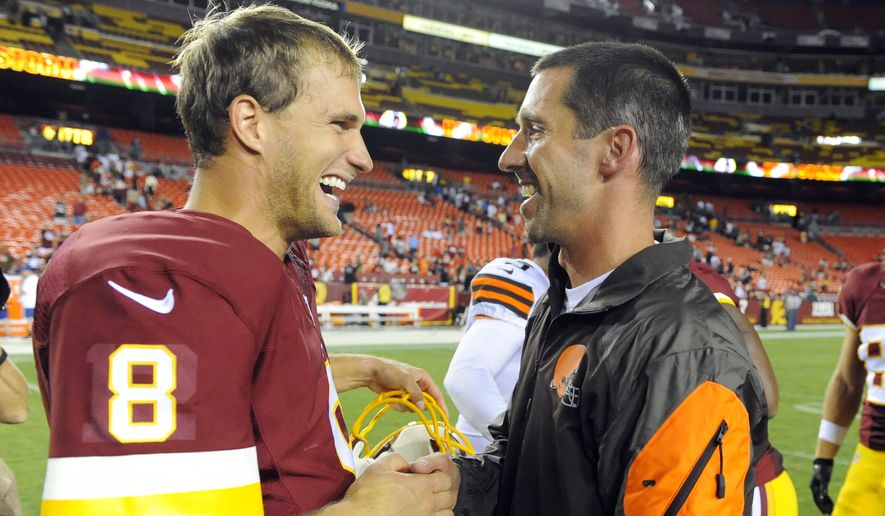 FILE - In this Aug. 18, 2014, file photo, Washington Redskins quarterback Kirk Cousins (8) talks with then-Cleveland Browns offensive coordinator Kyle Shanahan after an NFL preseason football game, in Landover, Md. Facing the first offensive coordinator who believed in him in now San Francisco 49ers coach Kyle Shanahan, Cousins is still evolving and improving as a quarterback for the Redskins. (AP Photo/Richard Lipski, File) **FILE**