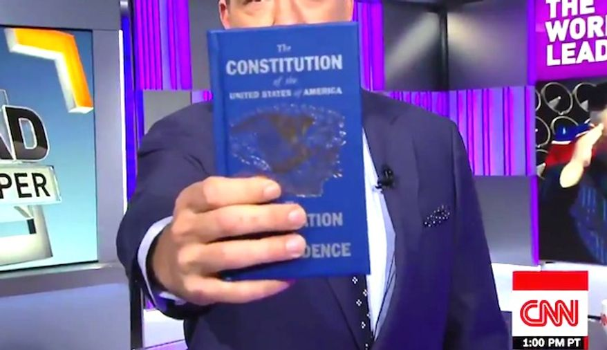 CNN'S Jake Tapper holds up a copy of the U.S. Constitution while admonishing President Trump on Oct. 11, 2017. (Image: CNN screenshot)