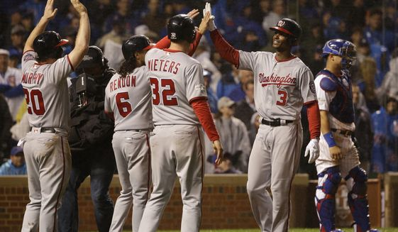 Washington Nationals' Michael Taylor (3) celebrates after hitting a grand slam against the Chicago Cubs during the eighth inning of Game 4 of baseball's National League Division Series, Wednesday, Oct. 11, 2017, in Chicago. (AP Photo/Nam Y. Huh)