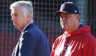 FILE - In this April 14, 2017, file photo, President of Baseball Operations David Dombrowski, left, and manager John Farrell stand on the field before a baseball game against the Tampa Bay Rays, in Boston. The Red Sox announced Wednesday, Oct. 11, 2017, that Farrell will not return as the club's manager for the 2018 season. President of Baseball Operations Dave Dombrowski made the announcement. (AP Photo/Michael Dwyer, File)